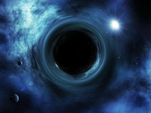 Физики сравнили черные дыры и голограммы